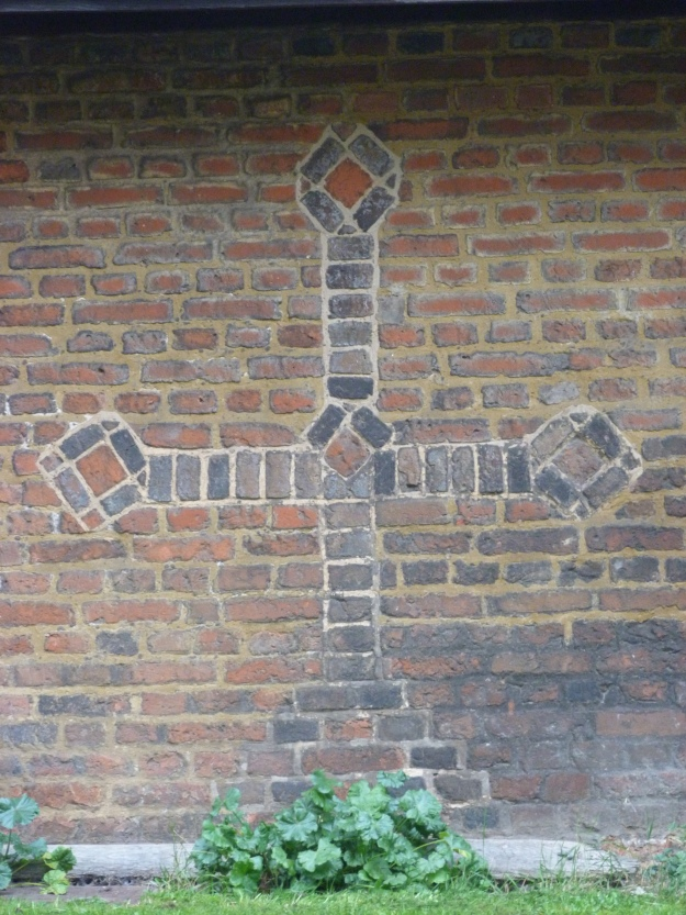 Brickwork Cross on wall of Cottages in Ruislip
