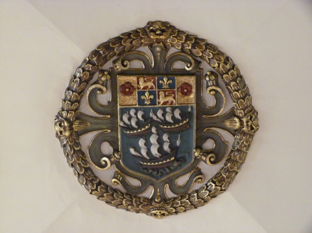Seventeenth-century ceiling boss bearing the coat of arms of the East India Company
