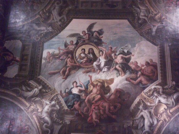The ceiling of the Upper Hall, featuring Queen Anne (reigned 1702-1714) and her husband George of Denmark
