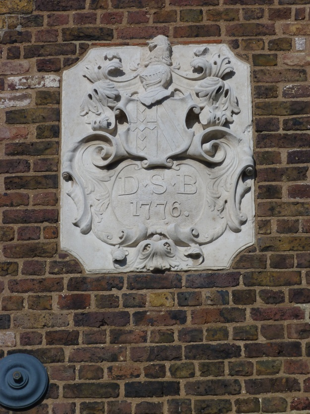 Cartouche on House Mill bearing initials of Daniel Bisson