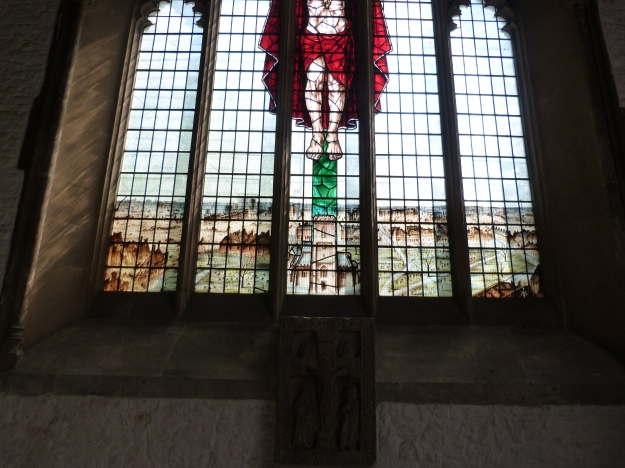 Modern stained glass window and Saxon rood (cross)
