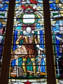 Stained-glass window depicting merchant-adventurer Captain John Smith (founder of Jamestown, Virginia)