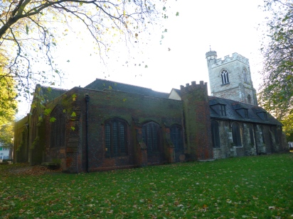All Saints - General view from rear, with Tudor brick chapel to left