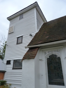 Weatherboarded west tower