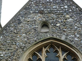 Saxon window above west door