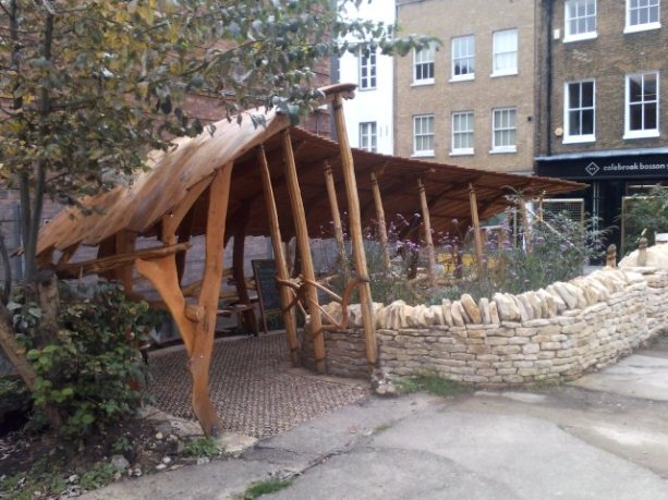 The recently-completed goose-wing shelter in the community garden