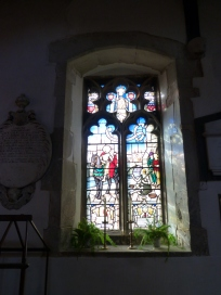 Stained glass window depicting St Martin