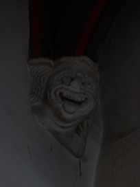 Carved stone head on corbel