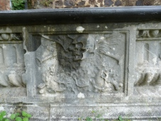 Close-up of tomb in churchyard