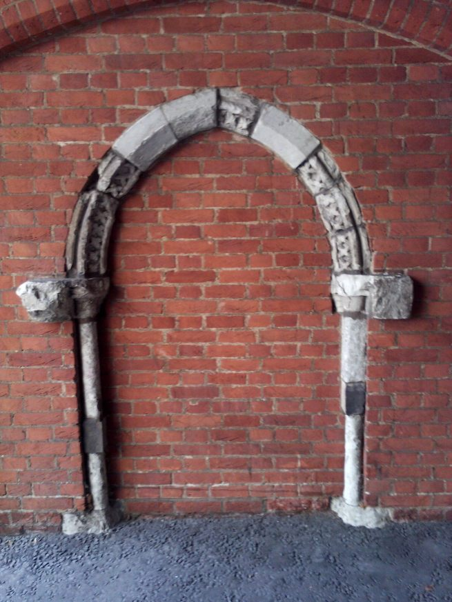 Medieval arch (from Bishop of Chichester's House), Lincoln's Inn Old Hall.jpg
