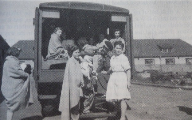 Inmates being boarded onto an ambulance.JPG