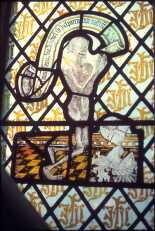 stained-glass-window-believed-to-depict-sir-henry-heydon-as-a-skeleton
